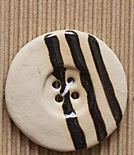 1 Extra large white button with black stripes