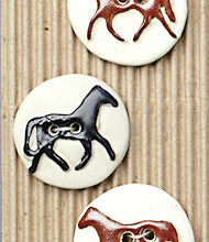 Brown and black horse buttons