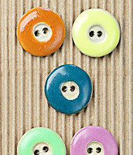 5 assorted colored buttons