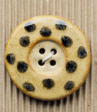 1 Large beige buttons with black spots