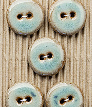 5 teal buttons