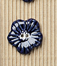 3 large navy flower buttons