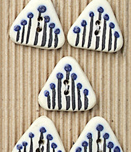 5 triangle shaped buttons painted with little blue flowers