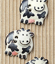 Black and white cow buttons