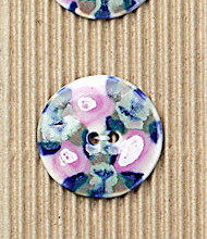 3 buttons painted with pink and blue flowers